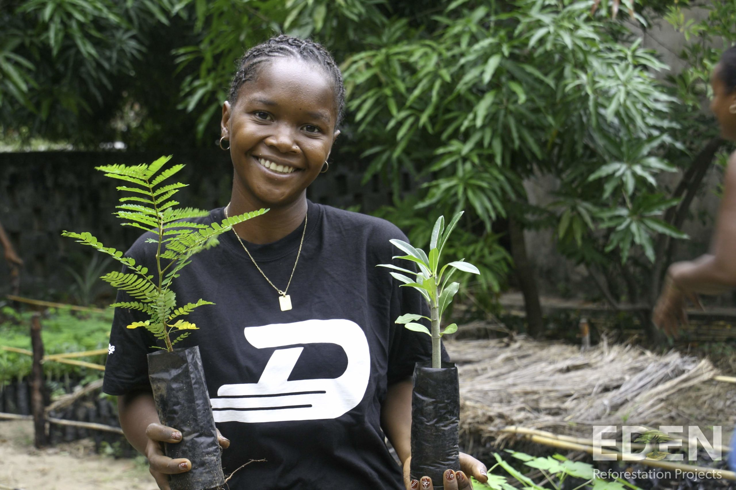 Madagascar_2013_Mamatiana-holding-seedlings-scaled.jpg